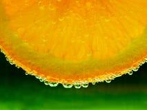 Naranja con las burbujas Foto de archivo