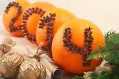 Naranja con los clavos Imagen de archivo libre de regalías
