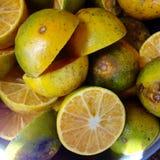 Naranja de la rebanada para el zumo de naranja Fotografía de archivo