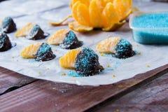 Naranja en chocolate en el Libro Blanco Imagen de archivo libre de regalías