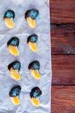 Naranja en chocolate en el Libro Blanco Imagen de archivo