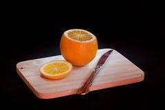 Naranja en fondo negro Fotografía de archivo libre de regalías
