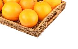 Naranja en la bandeja wickered Fotografía de archivo libre de regalías