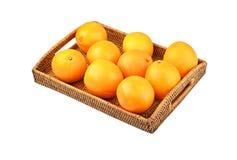 Naranja en la bandeja wickered Fotos de archivo libres de regalías