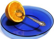 Naranja en la placa Imagen de archivo libre de regalías