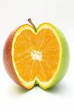 Naranja en manzana Fotografía de archivo