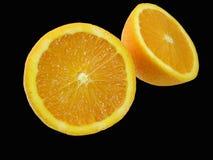 Naranja en negro Imagen de archivo libre de regalías
