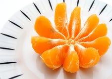 Naranja en placa Imagenes de archivo