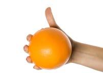 Naranja en una mano Fotos de archivo