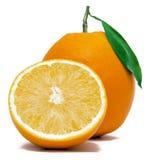 Naranja fresca con mitad Fotos de archivo