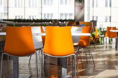 Naranja que cena sillas Fotografía de archivo libre de regalías