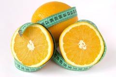 Naranja y cinta de la medida Imagenes de archivo
