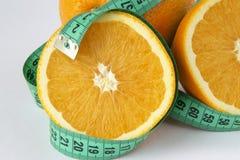 Naranja y cinta de la medida Foto de archivo