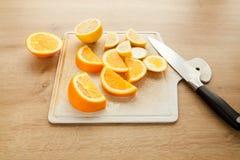 Naranja y limón cortados Fotografía de archivo