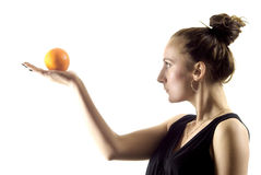 Naranja y muchacha Imágenes de archivo libres de regalías