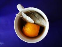 Naranja y té de hierbas fotografía de archivo libre de regalías