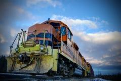 Naranja y tren del negro con el cielo tempestuoso Foto de archivo libre de regalías