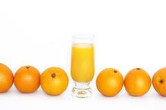Naranjas con el vidrio de jugo Fotos de archivo libres de regalías