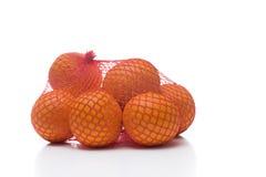 Naranjas en la red Imagenes de archivo
