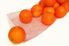 Naranjas en un bolso Imagen de archivo libre de regalías