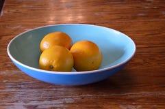 Naranjas en un cuenco Foto de archivo libre de regalías