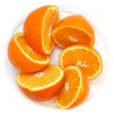 Naranjas en una placa Fotografía de archivo libre de regalías