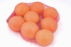Naranjas en una red Imagen de archivo