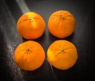 Naranjas fijadas en base de madera Imagen de archivo libre de regalías