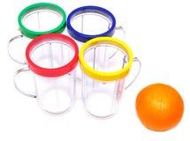 Naranjas frescas y vidrio vacío del jugo Fotos de archivo libres de regalías