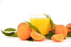 Naranjas y jugo Fotos de archivo libres de regalías