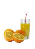 Naranjas y vidrio con el zumo de naranja Imagenes de archivo