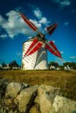 Narbon windmill in Brittany. The Narbon windmill and its red sails in Morbihan Royalty Free Stock Photos