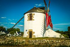 Narbon windmill in Brittany. The Narbon windmill and its red sails in Morbihan Royalty Free Stock Image