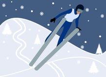 Narciarka robi narciarskiemu doskakiwaniu w górze Zdjęcia Royalty Free