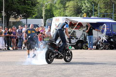 Narcis Roca burnout. With the motorcycle at the Iubim 2 roti (We love two wheels) event in Romania, at Romexpo. At this event it was seen a show made of Free Stock Photography