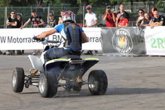 Narcis Roca drifting with the quad. At the Iubim 2 roti (We love two wheels) event in Romania, at Romexpo. At this event it was seen a show made of Free riders Royalty Free Stock Photos