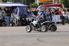 Narcis Roca drifting with the quad. At the Iubim 2 roti (We love two wheels) event in Romania, at Romexpo. At this event it was seen a show made of Free riders Stock Photos