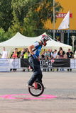 Narcis Roca tricks with the monocycle. Narcis Roca doing tricks with the monocycle at the Iubim 2 roti (We love two wheels) event in Romania, at Romexpo. At this Stock Image