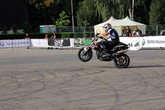 Narcis Roca wheelie. At the Iubim 2 roti (We love two wheels) event in Romania, at Romexpo. At this event it was seen a show made of Free riders and the line-up Royalty Free Stock Photography