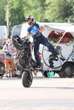 Narcis Roca wheelie. At the Iubim 2 roti (We love two wheels) event in Romania, at Romexpo. At this event it was seen a show made of Free riders and the line-up Royalty Free Stock Photo