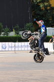 Narcis Roca wheelie. At the Iubim 2 roti (We love two wheels) event in Romania, at Romexpo. At this event it was seen a show made of Free riders and the line-up Stock Images