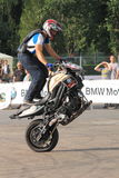 Narcis Roca wheelie. With one wheel motorcycle at the Iubim 2 roti (We love two wheels) event in Romania, at Romexpo. At this event it was seen a show made of Stock Photo