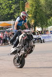 Narcis Roca wheelie. With one wheel motorcycle at the Iubim 2 roti (We love two wheels) event in Romania, at Romexpo. At this event it was seen a show made of Stock Photos