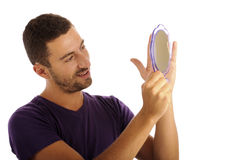 Narcissist looking in the mirror stock photo