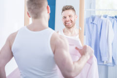 Narcissistic man choosing shirt Royalty Free Stock Image