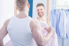 Narcissistic man choosing shirt Royalty Free Stock Image