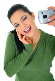 Narcissistic Mode. Pretty woman taking picture of herself using digital camera royalty free stock photo