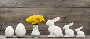 Narcissus flowers Easter bunny eggs decoration Stock Image