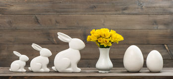 Narcissus flowers with easter bunny and eggs Royalty Free Stock Photography