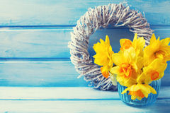 Narcissus in vase on wooden background Royalty Free Stock Photos